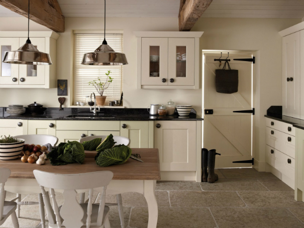 white country kitchen with black countertop