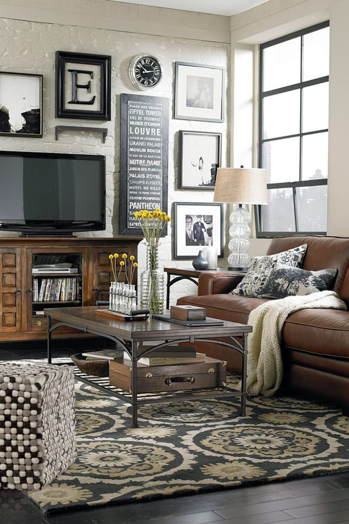 brown leather sofa and tv with frames in the background