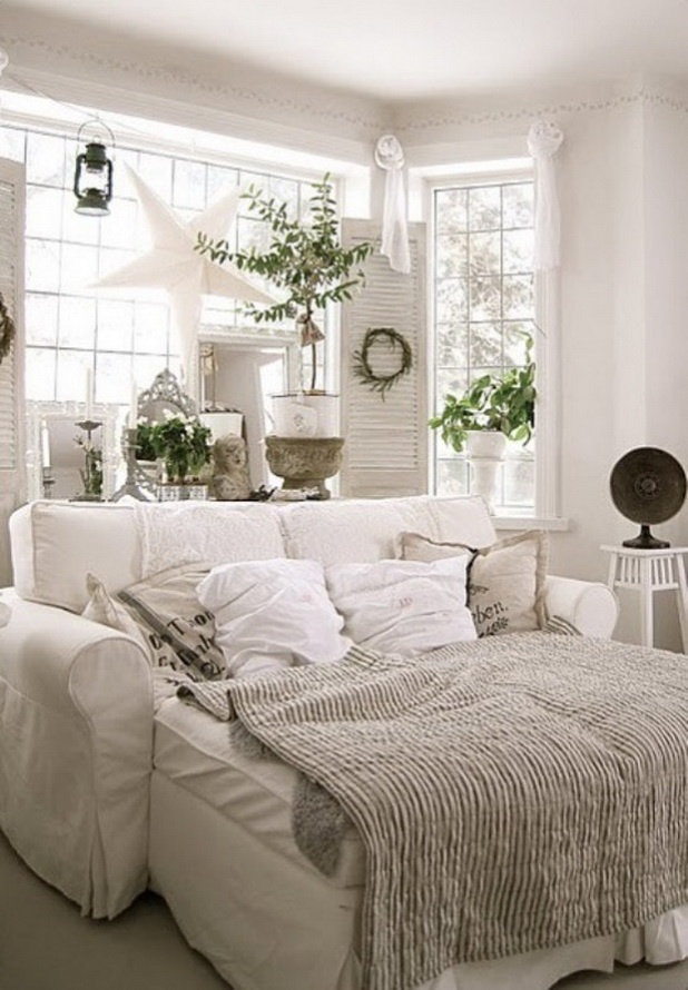 white sofa with indoor plants around