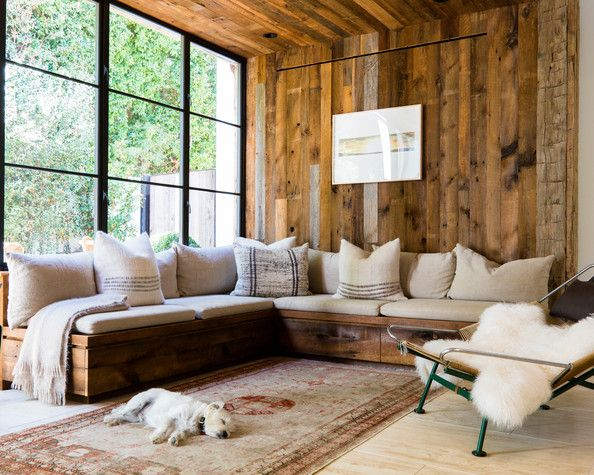 wood walls and beige sofa