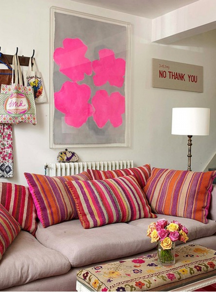 colorful pillows and a painting with pink details
