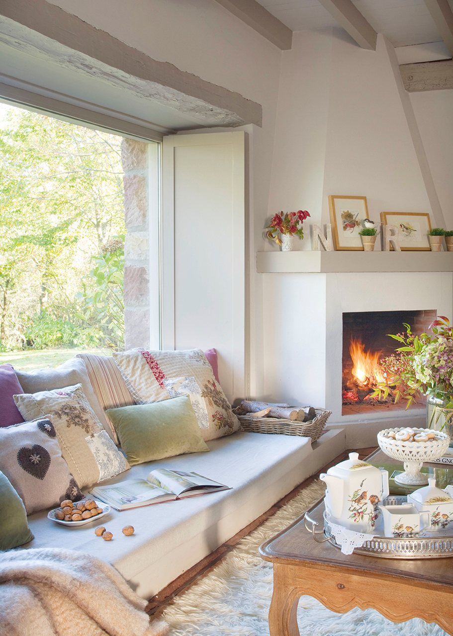 cozy living room with fireplace and low sofa under window - Decorating Ideas For Living Rooms With Fireplaces