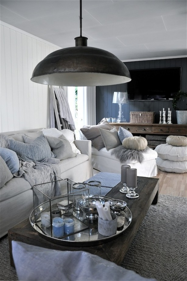 white sofa with decorative pillows on it