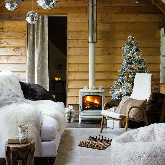 Christmas living room country decorating idea with stove and tree