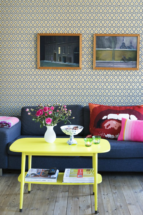 living room with bold yellow coffee table