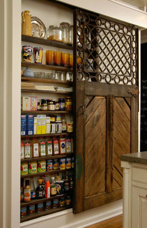 kitchen pantry created by opening the space between the studs in the wall