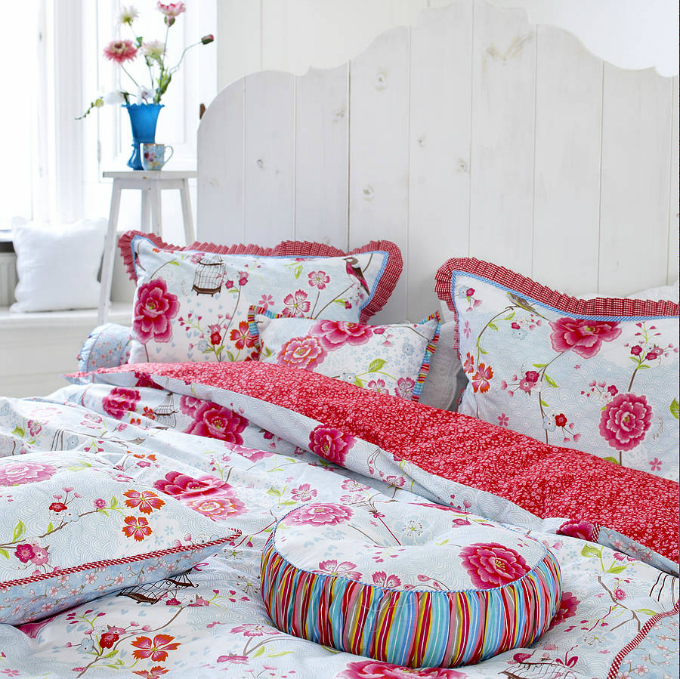multi colored comforter set in red