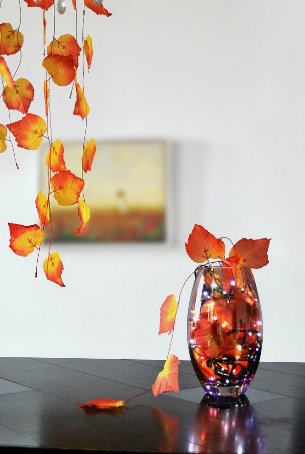 thanksgiving table decoration with leaves and fairy lights