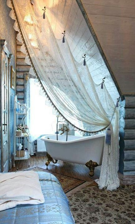 bathtub in bathroom and a big window