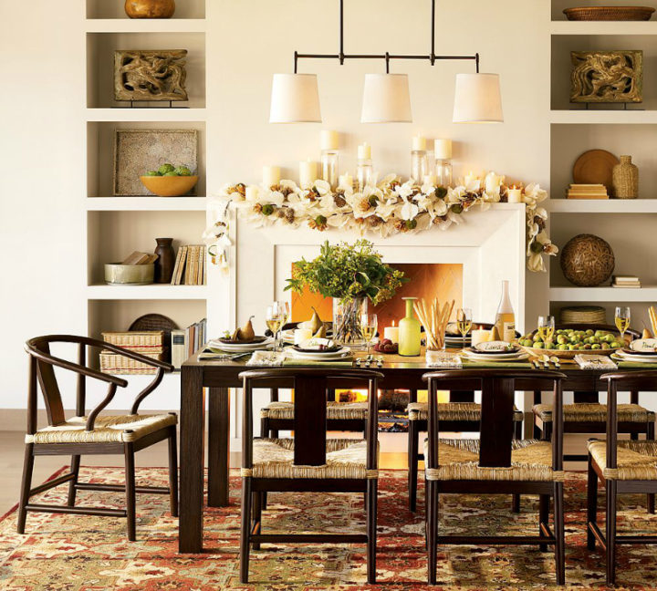 table with chairs near a fireplace