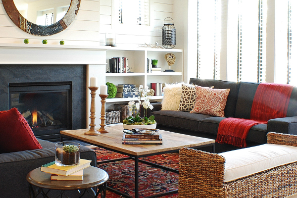 dark furniture and a fireplace