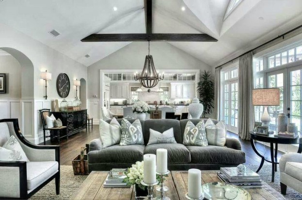 room full of furniture and exposed beams