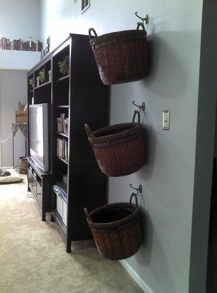buskets on the wall for storage space