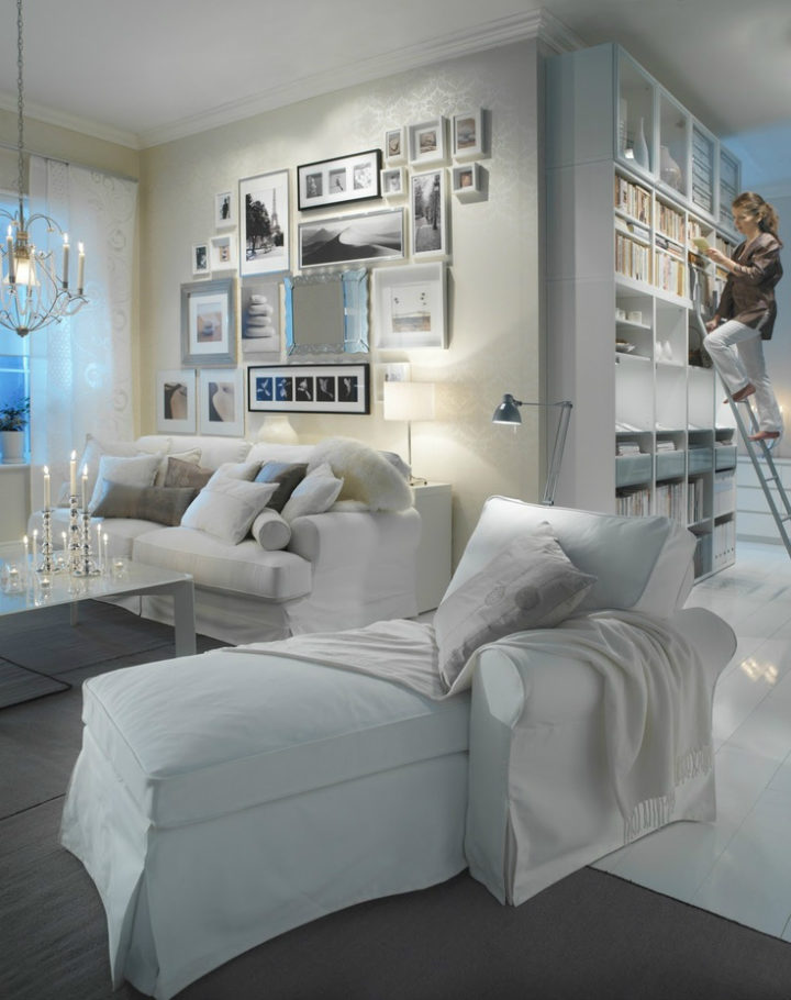 white interior with bookcase and many photo frames