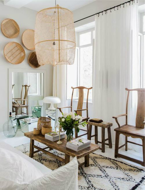 wood chairs and white curtains
