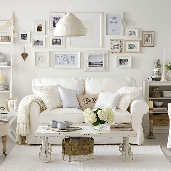 White Living Room Idea with frames and pillows