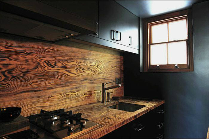 wood countertop in dark kitchen