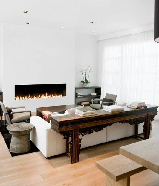 white walls and wood furniture