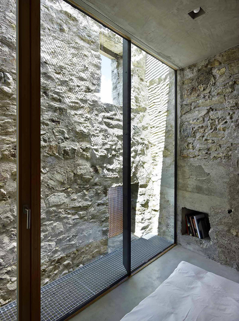 cave house contemporary stone interior 11