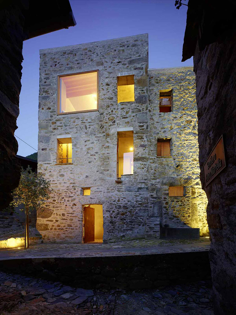 cave house contemporary stone exterior