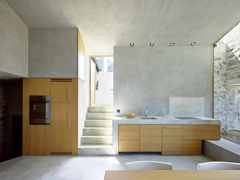light woof contemporary kitchen with concrete wall 2