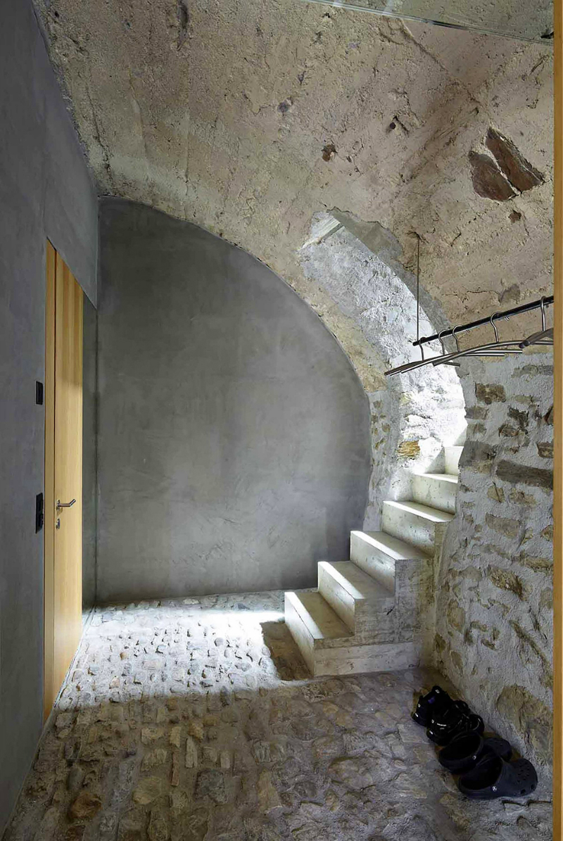 cave house contemporary stone interior stairs