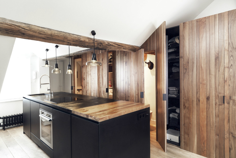 contemporary wood and black kitchen with wood beams