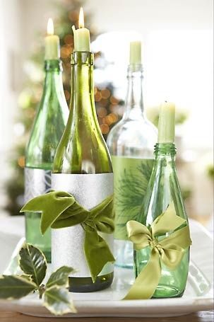 green bottles with candles