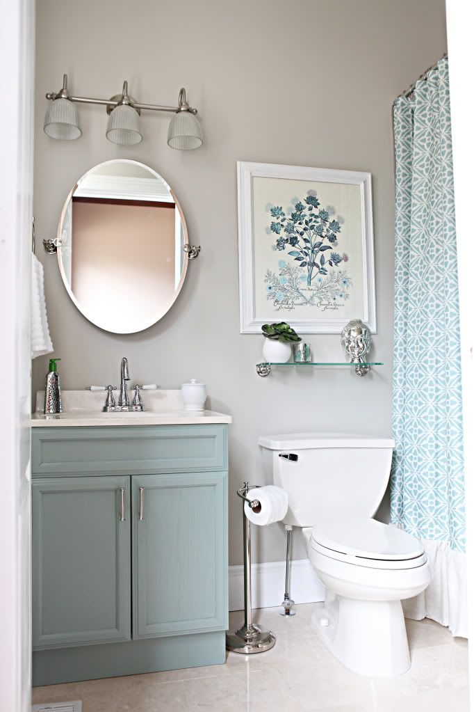 oval mirror in bathrom