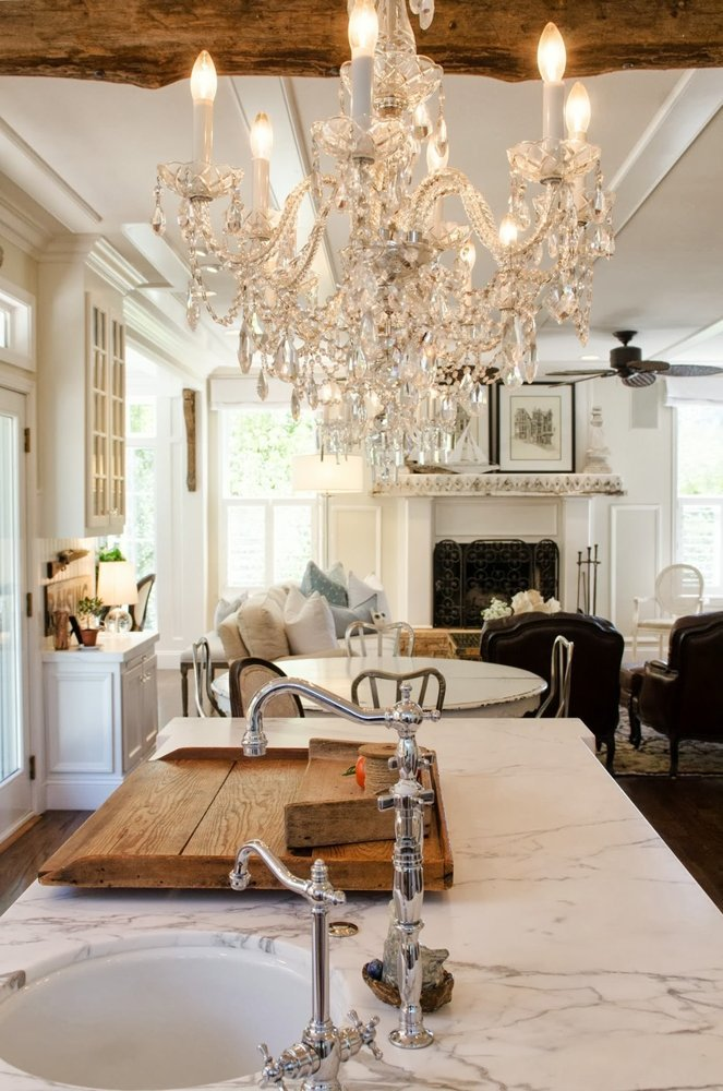 timeless kitchen with Carrara Marble countertop and crystal chandelier