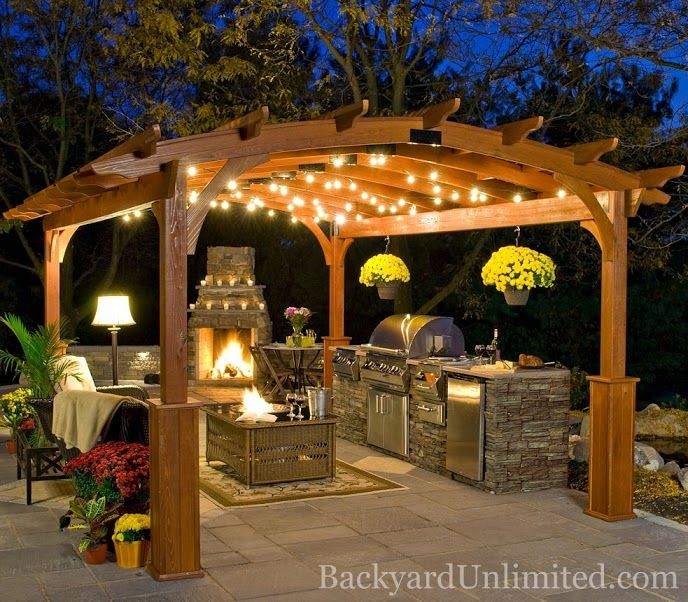 round wooden roof and a fireplace outdoors