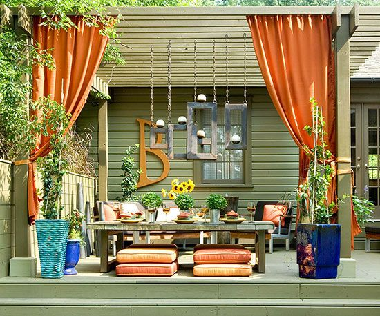 orange curtains in outdoor sitting area
