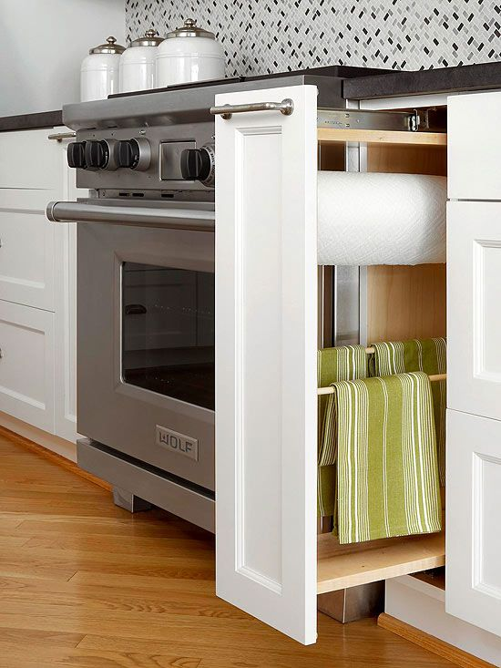 linens and paper towels out of sight with built-in kitchen storage