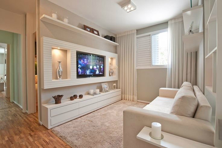 white living room with an enclosed TV