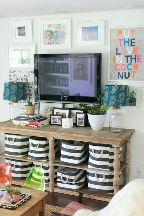 bright TV area in a white wall and storage furniture table