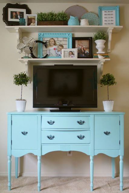 light blue furniture with shelves above the TV