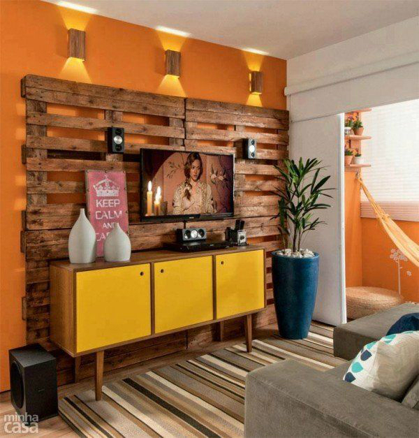 wood decoration in a TV area with yellow cabinet