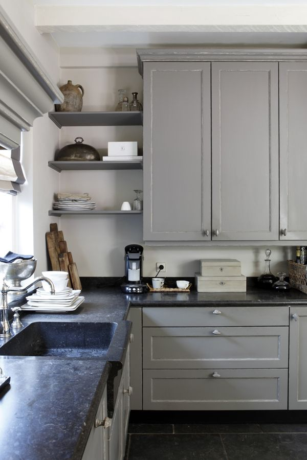 cupboards and shelves colored in a grey shade