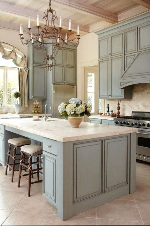 light grey cabinets and a special chandelier
