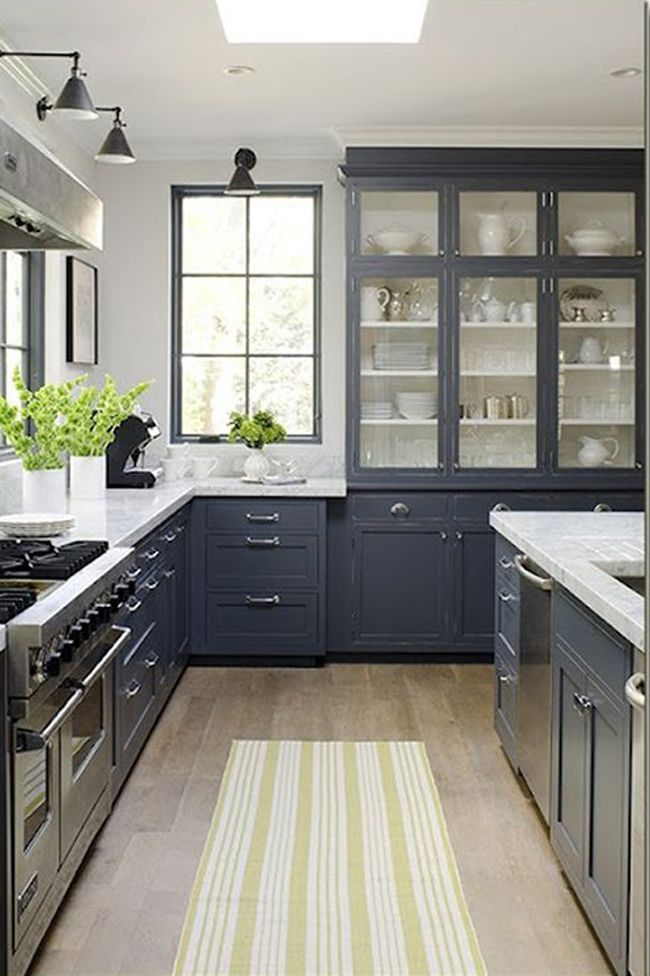 dark grey cabinets and a yellow striped carpet