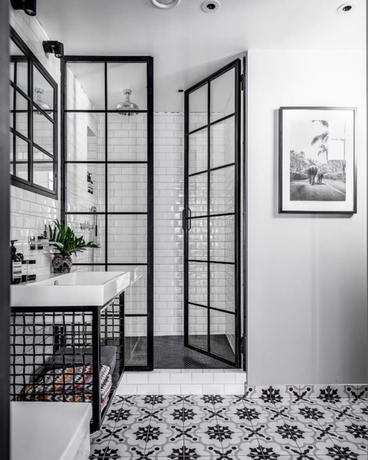 black and white walk in shower with french munting glass black metal closure doors