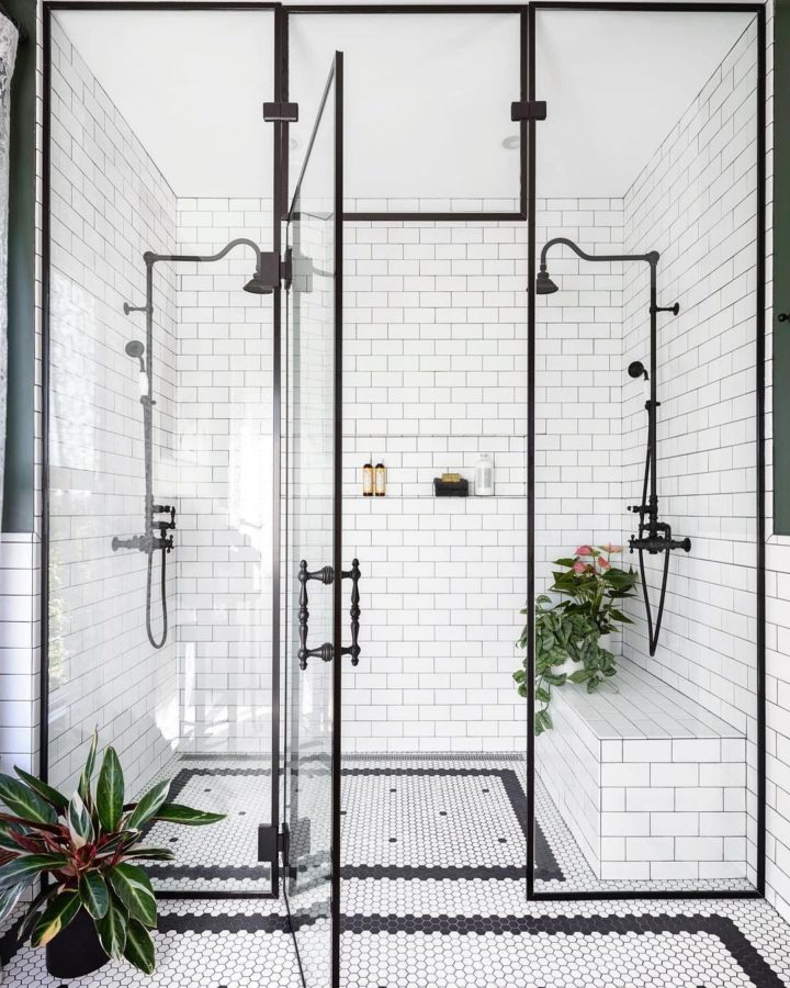black and white bathroom walk in shower with built in seat