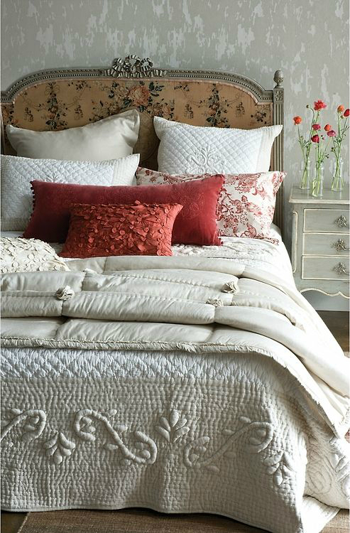 white and reddish double bed