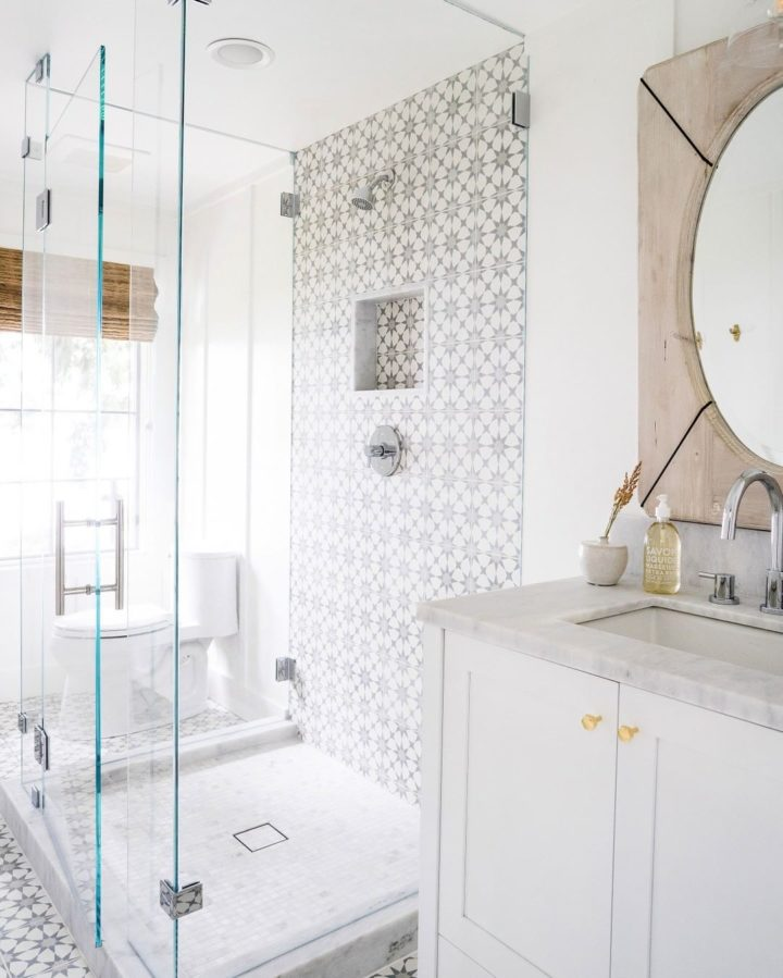 glass walk in shower with cement tiles