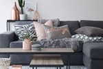 living room idea with dark gray sofa with copper and blush