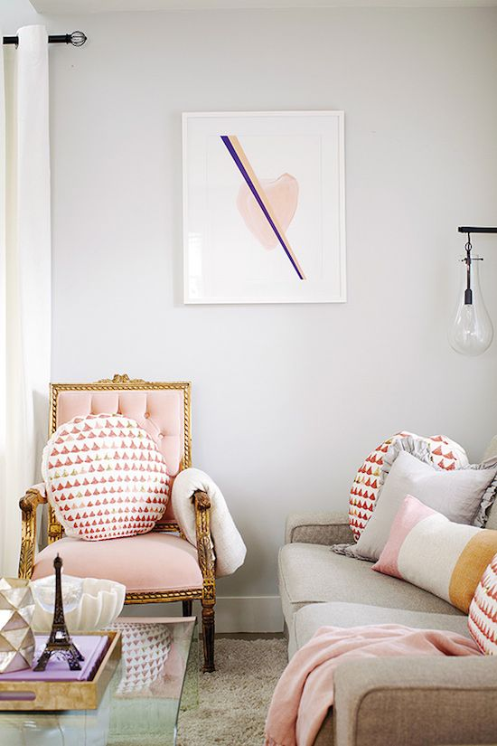 living room with pink furniture
