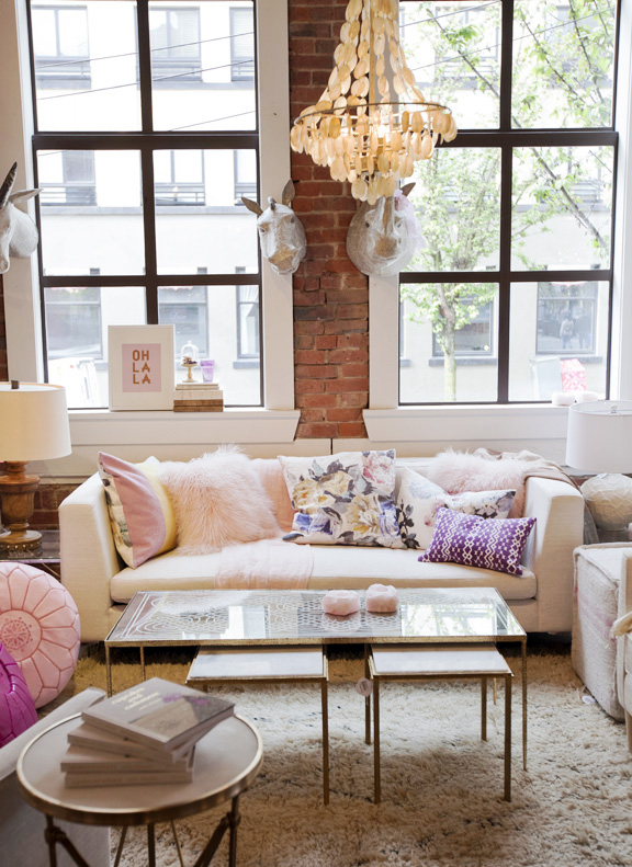 feminine living room with brick wall