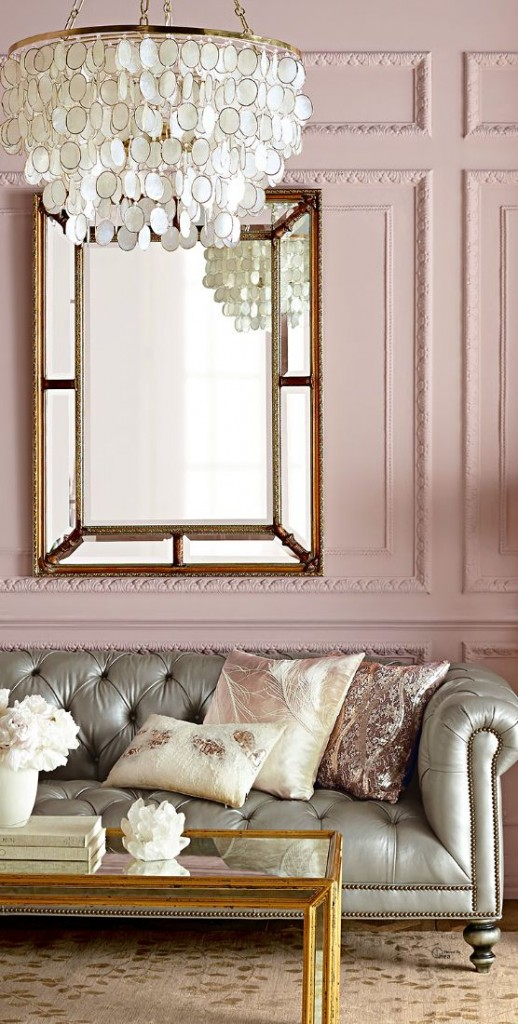 elegant living room with blush wall and gray leather tufted sofa