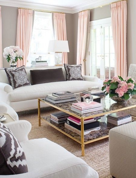 living room with gray walls and blush pink curtains