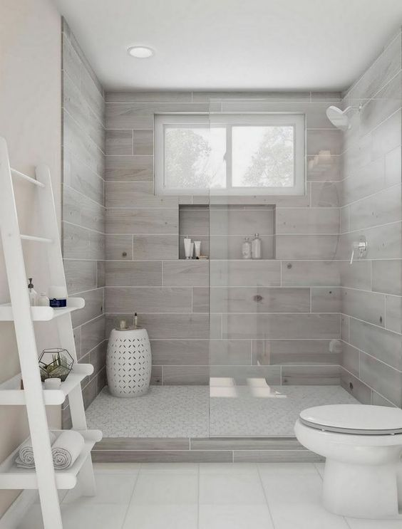 simple light fray and white walk in shower design